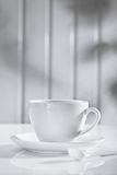 Ceramic coffee cup with spoon on white Stock Photography