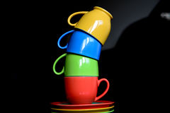 Ceramic coffee cups. Various color coffee cups on the table Royalty Free Stock Photos
