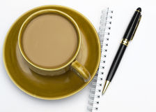 Ceramic coffee mug and pan. Coffee cup with note book on table Stock Photo