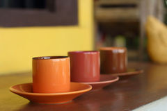 Ceramic coffee set plate at glass shop. Royalty Free Stock Images