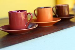 Ceramic coffee set plate at glass shop. Stock Images