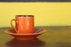 Ceramic coffee set plate at glass shop. Stock Photography
