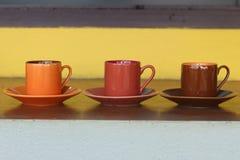 Ceramic coffee set plate at glass shop. Stock Photos