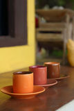 Ceramic coffee set plate at glass shop. Royalty Free Stock Photography