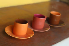 Ceramic coffee set plate at glass shop. Stock Photo