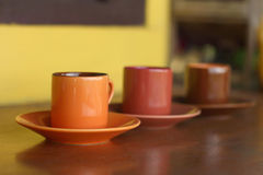 Ceramic coffee set plate at glass shop. Stock Photos