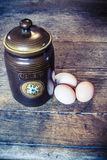 Ceramic cointainer and eggs Royalty Free Stock Photography