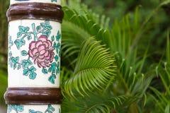 Ceramic column and palm tree Royalty Free Stock Image