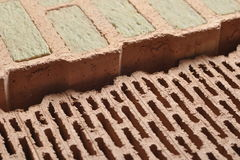 Ceramic construction bricks. Two types of ceramic bricks with cavities, ones with mineral insulation wool and others with air gaps Stock Images