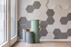 Ceramic containers in kitchen. Close-up of ceramic containers, jug and hexagon tiles in kitchen royalty free stock photo