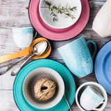 Ceramic crockery on wooden background. Ceramic crockery tableware on wooden background. Pastel vintage color bowls, dishes, cups Royalty Free Stock Photography