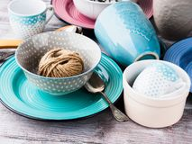 Ceramic crockery on wooden background. Ceramic crockery tableware on wooden background. Pastel vintage color bowls, dishes, cups Stock Image