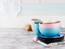 Ceramic crockery on wooden background. Ceramic crockery tableware on wooden background. Pastel vintage color bowls, dishes, cups Stock Images