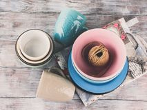Ceramic crockery on wooden background. Ceramic crockery tableware on wooden background. Pastel vintage color bowls, dishes, cups Royalty Free Stock Image