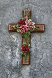 Ceramic cross with flowers. Ceramic cross in a cemetery Royalty Free Stock Photo