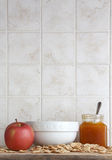 Ceramic cup with an apple and jam, space for text Royalty Free Stock Photography