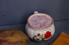 Ceramic cup with atole stock images