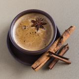 Coffee, coffee beans, spices, star anise, cinnamon, sugar, canvas royalty free stock photography
