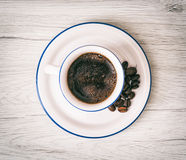 Ceramic cup of coffee with coffee beans, pick-me-up, morning rit Stock Photos