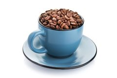 Ceramic cup filled with roasted coffee beans. Isolated on a white background Stock Images