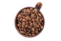 Ceramic cup filled with roasted coffee beans. Isolated on a white background. top view Royalty Free Stock Photography