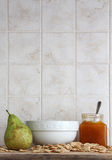 Ceramic cup, fruit and jam, cereal flakes Royalty Free Stock Image
