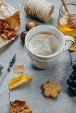 Ceramic cup of Herbal tea, almonds, grapes, honey, figs, dry lea Royalty Free Stock Photography