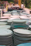 Ceramic cup, Many white different plates stacked together. Stock Photography