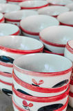 Ceramic cup, Many white different plates stacked together. Stock Photos