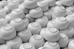 Ceramic cup, Many white different plates stacked together. Stock Photo