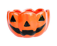 A ceramic cup with pumpkin halloween face shape. Royalty Free Stock Photos