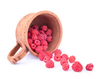 Ceramic cup with raspberries. Scattering on the white background Stock Images