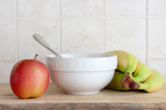 Ceramic cup and some fruit Royalty Free Stock Image