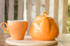 Ceramic cup of tea and teapot Royalty Free Stock Photography