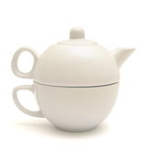 Ceramic cup and teapot. Two piece tea set, a cup and a teapot Royalty Free Stock Image
