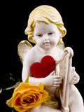 Ceramic cupid on black background Royalty Free Stock Photography