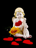 Ceramic cupid with felt heart and tea rose Stock Images