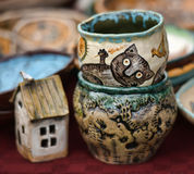 Ceramic cups and bowls with funny drawings Stock Image