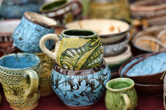 Ceramic cups and bowls with funny drawings Stock Photo