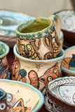 Ceramic cups and bowls with funny drawings Royalty Free Stock Image