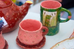 Ceramic cups and kettle Stock Photos