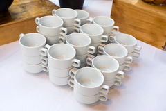 Ceramic cups pile on table Royalty Free Stock Photos