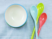 Ceramic cups and plastic spoons Stock Photos
