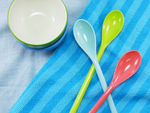 Ceramic cups and plastic spoons Stock Image