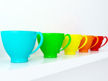 Ceramic cups on the shelf. Stock Images