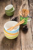 Ceramic cups and wooden spoons Royalty Free Stock Photography