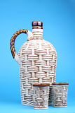 Ceramic decanter and glass. With wine on blue background Royalty Free Stock Photos
