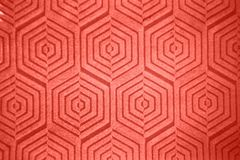Figured creative hexagon pattern of ceramic wall in a trendy color of the year 2019 Living Coral pantone. royalty free stock photos
