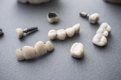 Ceramic dentures and crowns on gray background Stock Photography