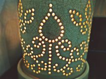 Ceramic diffuser filled with natural essential oil diluted light candles stock photography
